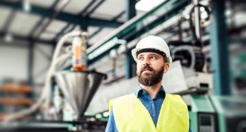 man standing in industrial plant